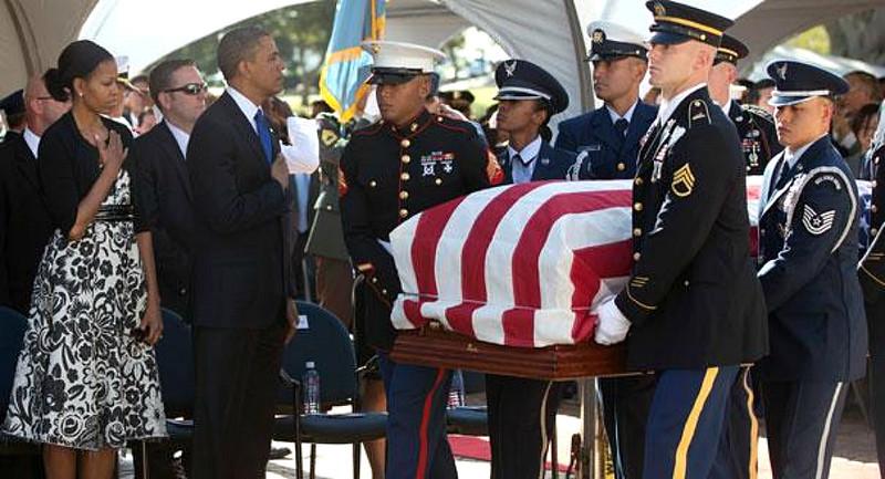 The Obamas greeting Inouye's casket at Punchbowl (Honolulu Star Advertiser).