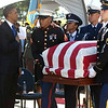 The Obamas greeting Inouye's casket at Punchbowl (Honolulu Star Advertiser).