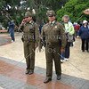 Local town security personnel walk around at a square in Punta Arenas, Chile.