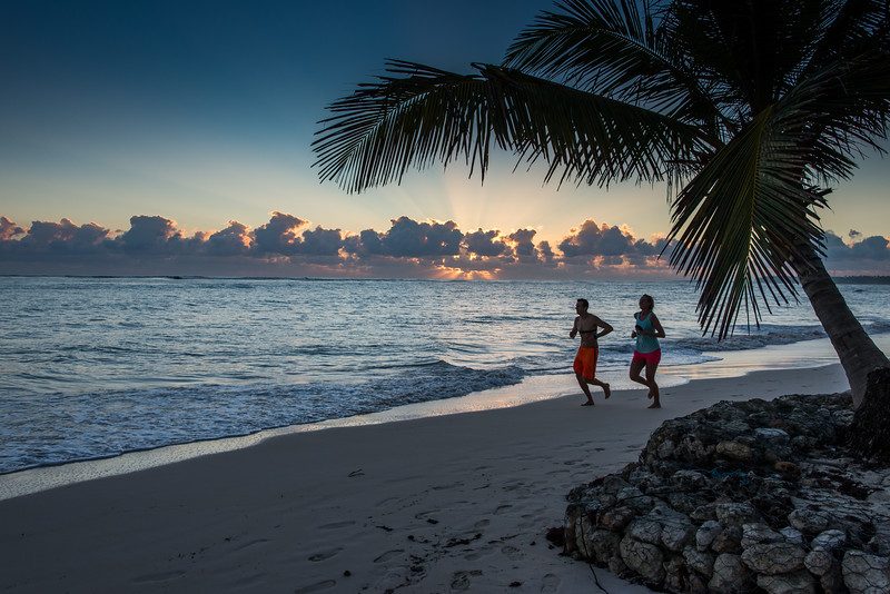 Couple out for late afternoon jog along beach in Punta Cana, Dominican Republic - January 2017