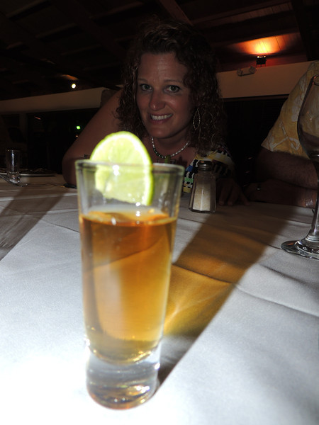 A collection of photos of Lisa having a chili infused tequila shot. (It was a very spicy, hot shot.)