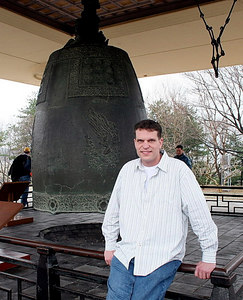 Sacred bell of King Seongdeok the Great.   Sightseeing near Pusan, South Korea. This bell is 10 feet high, 22 times the weight of the Liberty Bell and cast of solid bronze.