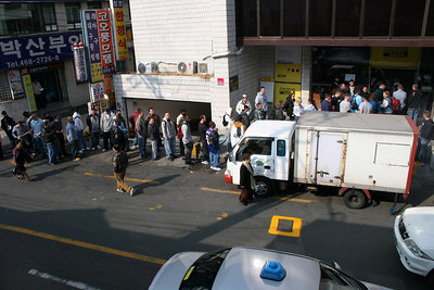 All the sailors waiting in line for the ATM.  Little did they know, there were a few more just a block away