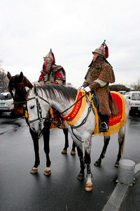 Traditional Korean warriors on horseback near the museum