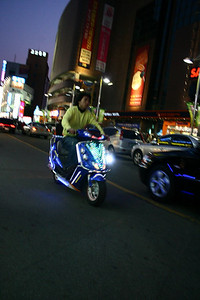 This dude was buzzing around all night.  Great lights on his scooter