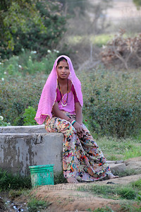 Women doing house hold chores like washing the vessels at the village well.  The town of Pushkar is located 14 km North West of Ajmer. Pushkar is one of the oldest cities of India. It  has in recent years become a popular destination for foreign tourists. Pushkar, Rajasthan, India.
