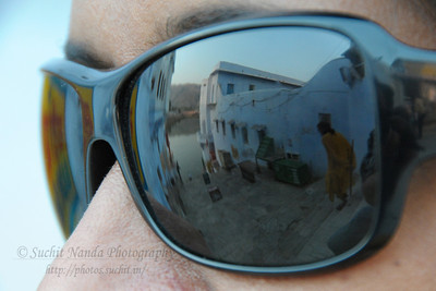 Reflections of Pushkar in Anu's eyes.  The town of Pushkar is located 14 km North West of Ajmer. Pushkar is one of the oldest cities of India. It  has in recent years become a popular destination for foreign tourists. Pushkar, Rajasthan, India.