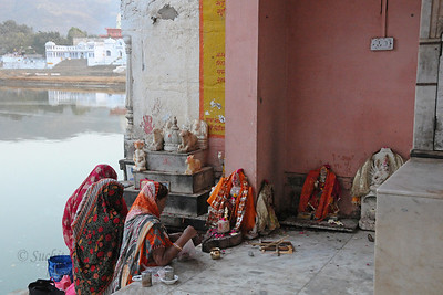 Evening puja at Pushkar Lake.  The town of Pushkar is located 14 km North West of Ajmer. Pushkar is one of the oldest cities of India. It  has in recent years become a popular destination for foreign tourists. Pushkar, Rajasthan, India.