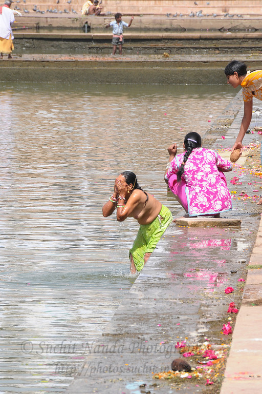 Women take a dip in the holy Pushkar Lake waters in Rajasthan.<br /> <br /> The town of Pushkar is located 14 km North West of Ajmer. Pushkar is one of the oldest cities of India. It  has in recent years become a popular destination for foreign tourists. Pushkar, Rajasthan, India.