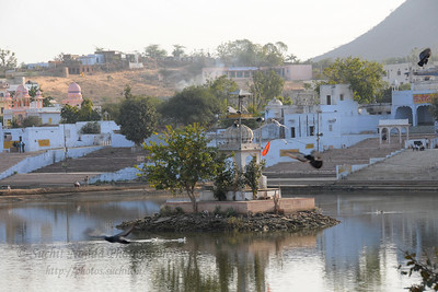 View of Pushkar Lake from the ghats. The town of Pushkar is located 14 km North West of Ajmer. Pushkar is one of the oldest cities of India. It  has in recent years become a popular destination for foreign tourists. Pushkar, Rajasthan, India.