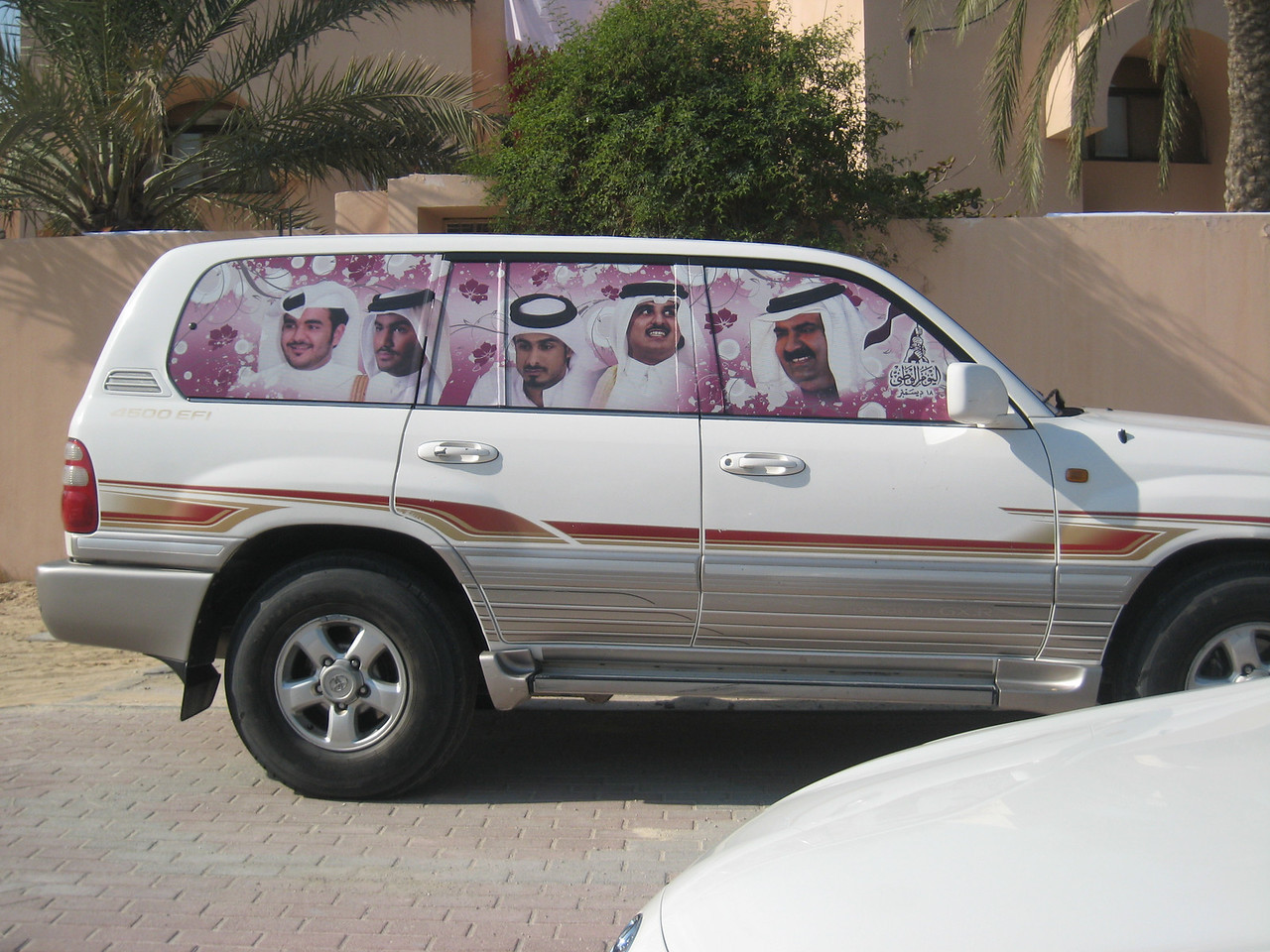 The side of the same car showing the Qatari ruling Al Thani family.  The Emir, H.H. Hamad bin Khalifa al Thani is pictured on the far right. Pictured next is the Heir Apparent, H.H. Tamim bin Hamad al Thani et ors.