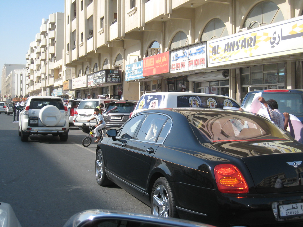 The row of car accessory shops who are flat out on national day applying decals to