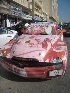 This is 'how we roll' in Qatar on National Day.  Note the windscreen is completely covered, you can see through it, sort of, its like looking out of a bus window when an advertisement has been attached to the side.  Many cars used to have their windscreens covered in decals like this in the UAE on UAE National Day until the government finally stepped in.