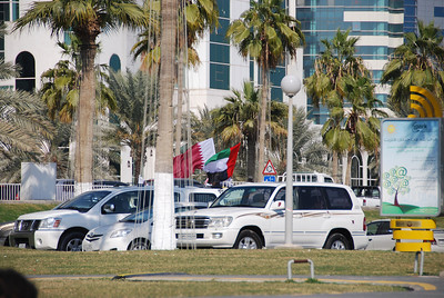 The Qatar and the UAE flags.  Standing up through the sunroof waving either a flag or a sword becomes a national pastime on 18 December.