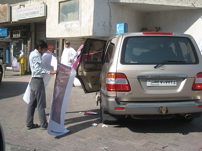 The choice of pictures has been made and a worker prepares to position the decal onto