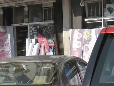 Rolls of patriotic pictures of the Qatari ruling family outside one of the shops.