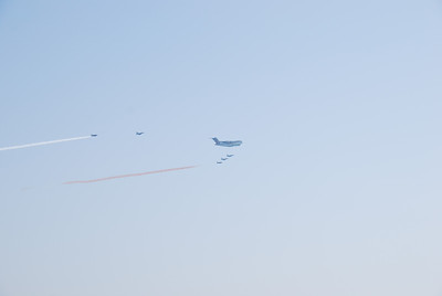 The Hercules and fighter escort.