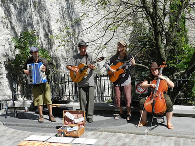 Some of the many street musicians licensed by the city