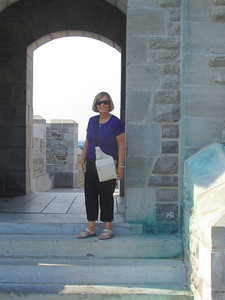 Donna at entrance of tower on the wall surrounding the old city