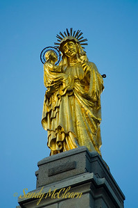 A gold plated statue of the Virgin Mary and Jesus in Quebec City.