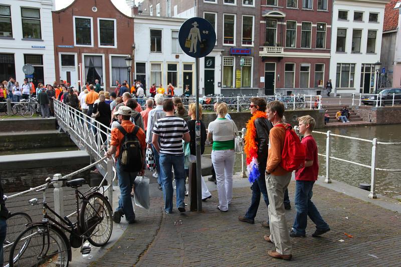 People crossing one of the locks in Utrecht.