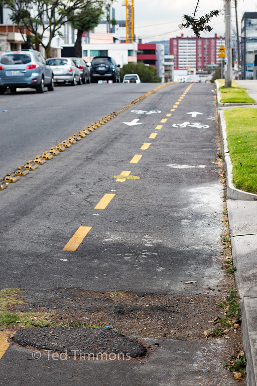 Poor pavement quality, but it's great to have a bike lane demarcated by more than paint.