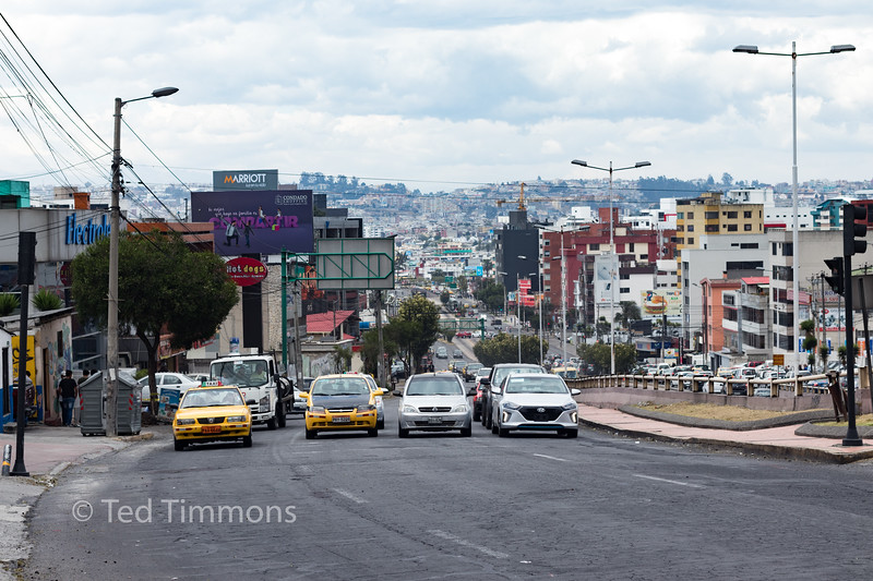This is a familiar street scene in Quito: wide roads with tons of traffic.