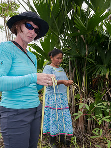Veronica learns to braid palm fronds.