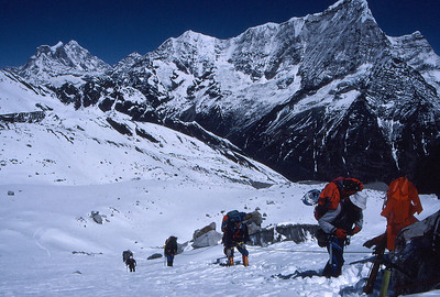 Climbing just below the ice fall at the snout of the Ramdung Glacier, Gauri Shankar in the distance, the Rowaling Valley below