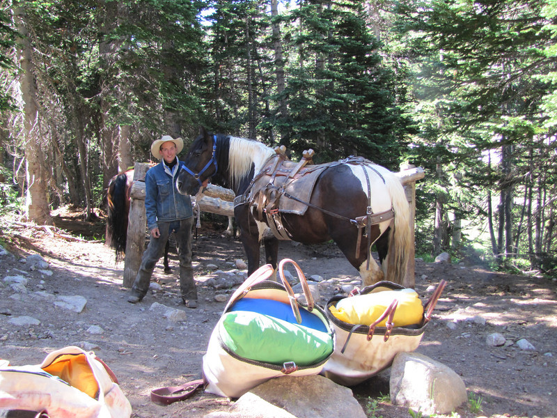 "Cody from Sombrero Ranches ( <a href=""http://www.sombrero.com"">http://www.sombrero.com</a>) and his pack horses. Packing up gear for customers that paid to have their gear packed in and out for a comping trip."