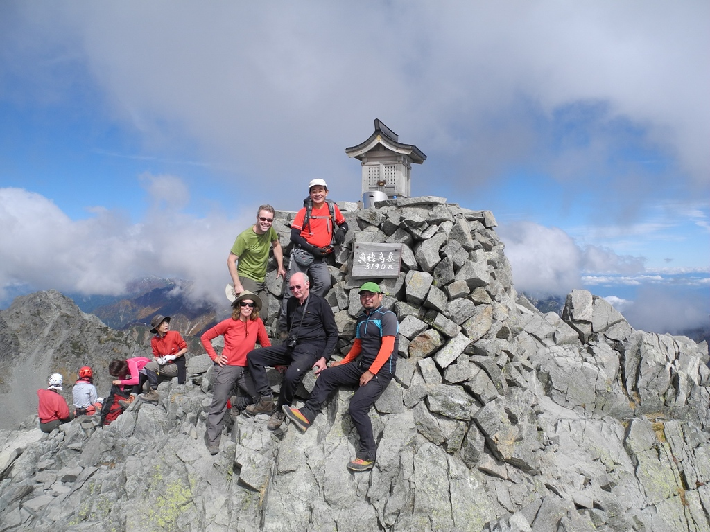 Four climbers with Tom, guide, on Oku Hotaka (3,190m), the third highest mountain in Japan..