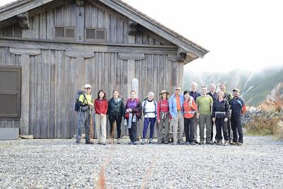Team photo at start of trek outside old Murodo mountain hut.
