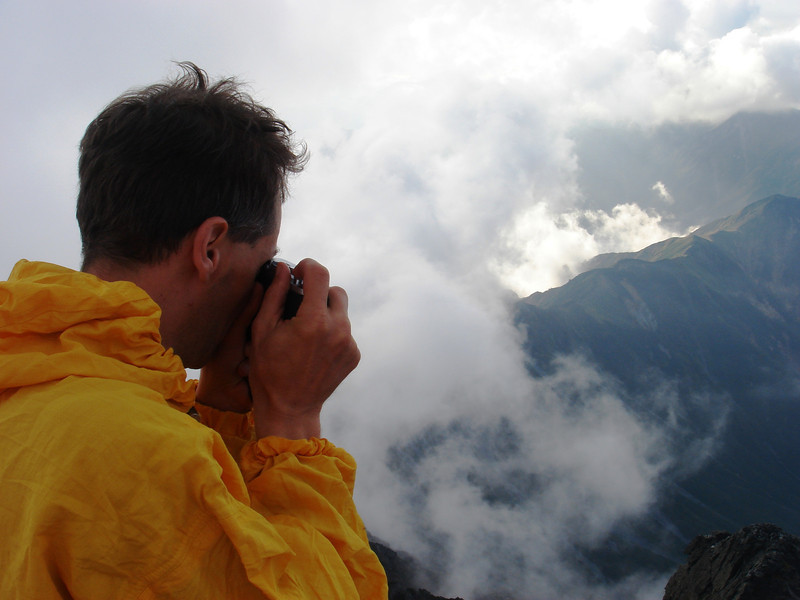 PHOTOGRAPHING ON TREK IN THE NORTH ALPS.