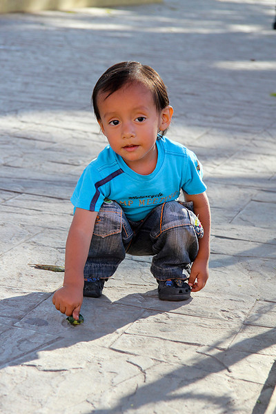 Near the church, this little two year old found a nut on the sidewalk that...