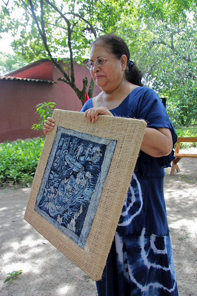 Rena shows us samples of artwork made from the indigo dye.