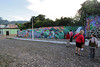 The town is noted for the colorful murals painted on the fences, houses and small businesses of the village.