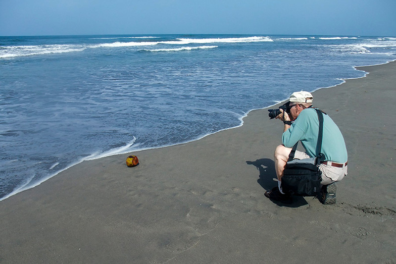 After a good nights rest at the Hotel Pacific Paradise this photographer finds something to peek his interest on the grey sandy beach of Costa del Sol on the Pacific.