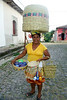 This woman, who enjoyed posing for pictures, was a hard working street peddler selling baskets and other woven items.