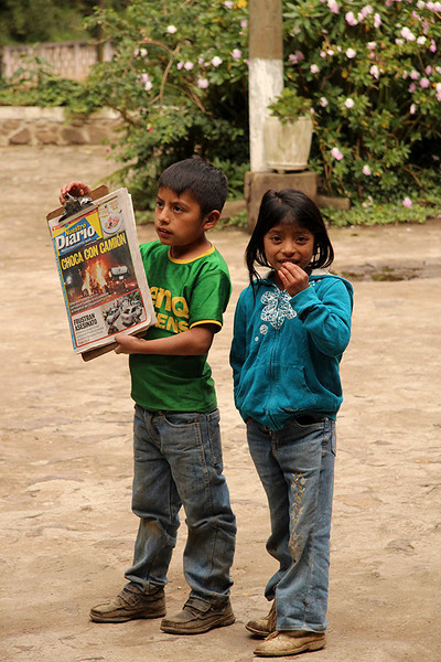 Young boy selling newspapers in a small town we passed through.