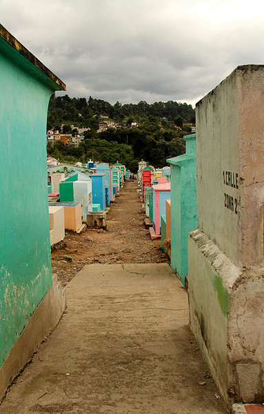 We stopped and found it to be a cemetery with many of the above ground tombs brightly painted.