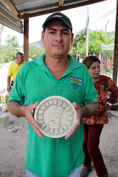 This artist made a disk representing one of the Mayan calendars. We bought it!
