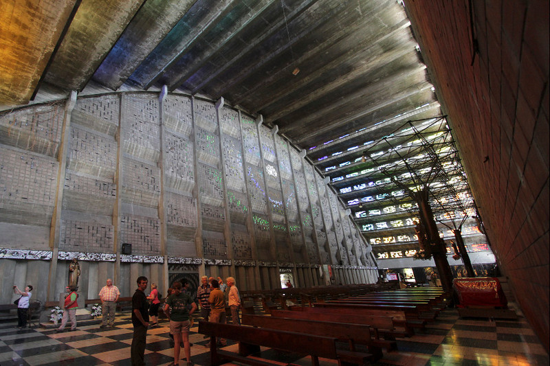 The main sanctuary's roof consists an arch of tiers of concrete and stained glass windows.