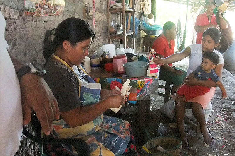 Some of the women make traditional corn husk dolls for the children to sell for a little money.
