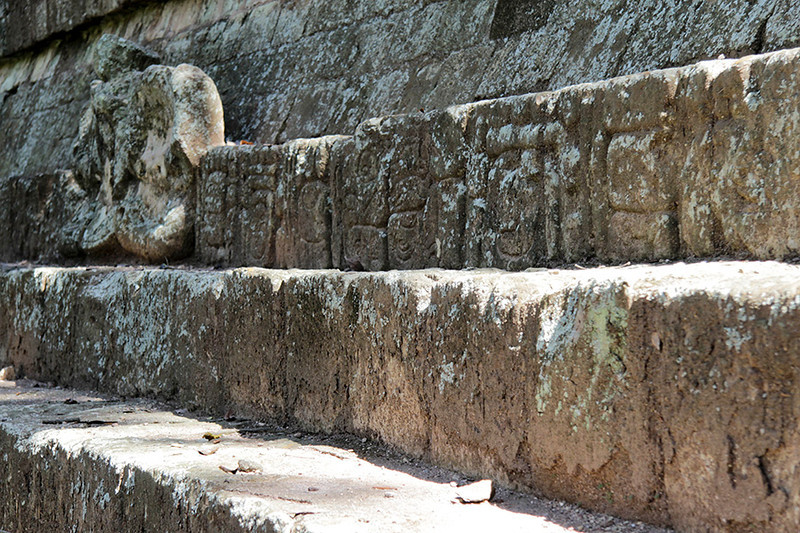 Glyphs are carved into many of the stones of the temple steps.