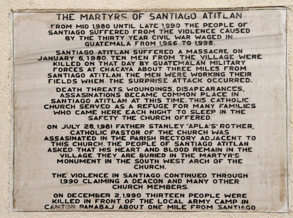 Plaques commemorating Father Aplas and others hang in the sanctuary.