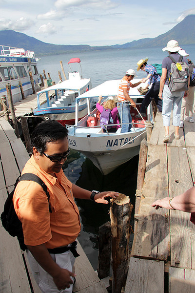 Our guide, Walter, assists us as we board the NATALY for a trip across the lake to Santiago Atitlan.