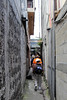 Walking through a narrow alleyway being careful not to step on the dog, we found...