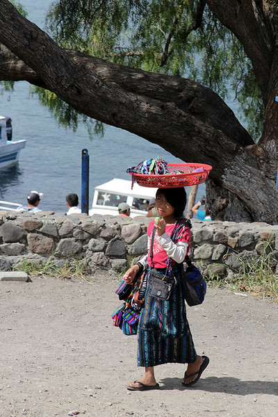 "In route to the dock where our ""Chicken Boat"" awaits, we saw this young girl carrying her wares to the main street to sell."