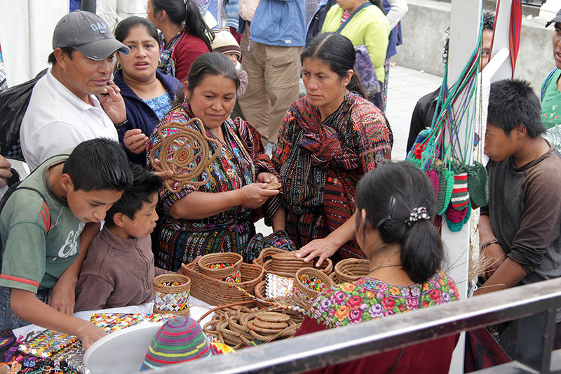 Almost all of the 14,000 residents of Solola are of Maya descent and many still wear the traditional clothing. The woman managing this booth was the artist who had developed a way to utilize ordinary pine needles and left over candy wrappers into these works of art. She is imaginative, creative and recycles too.