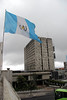 This is the Guatemalan flag. A government building looms behind.